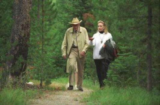 Hillary Clinton y Laurence Rockefeller.