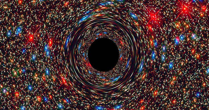 Hallan un agujero negro supermasivo, posiblemente el más grande del Universo