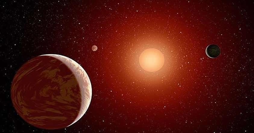Representación de un sistema planetario en torno a una enana roja. Estas estrellas son las más longevas y, por tanto, las que más tiempo le dan a la vida para desarrollarse.