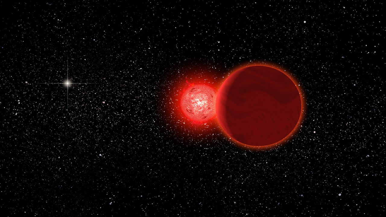 Hallan una enana roja oculta en el polvo de una estrella gigante