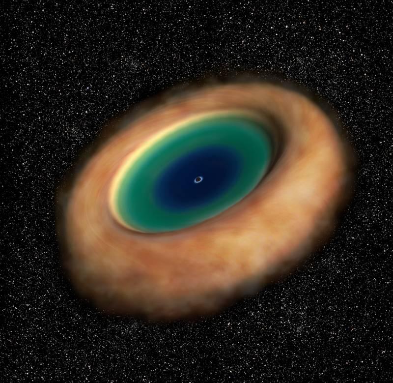 Representación artística del toroide de polvo y gas que rodea el agujero negro supermasivo. ALMA reveló la rotación del toroide con mucha precisión por primera vez
