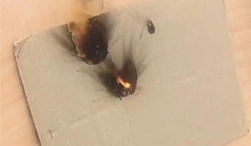 Una imagen fija del metraje muestra el objetivo en llamas después de que la pistola láser aparentemente se haya probado desde cierta distancia.