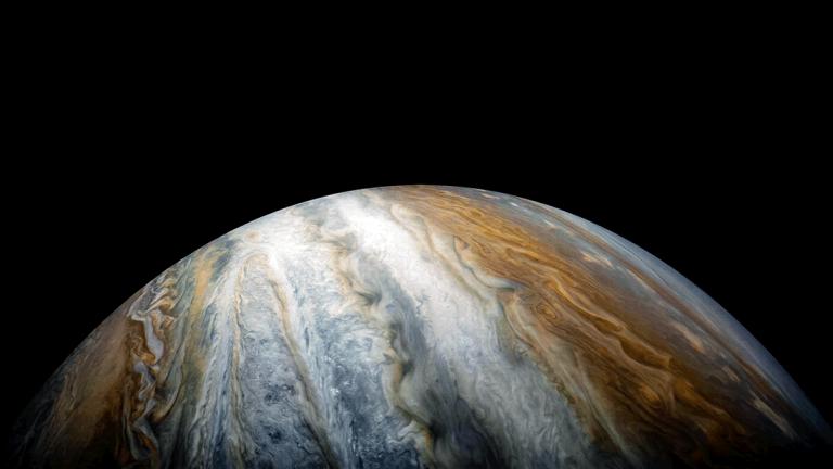 Misión Juno captura una «barcaza marrón» en Júpiter