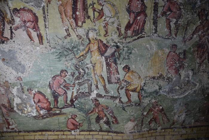 El dios Dionysos y otros dioses realizando la limpieza del sitio de Capitolias junto a otros hombres. Las representaciones de deidades que interactúan con mortales de esta manera son extremadamente raras en el arte grecorromano