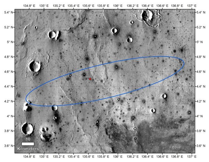 El punto rojo marca el lugar final de aterrizaje de InSight de la NASA en esta imagen anotada de la superficie de Marte, tomada por la cámara THEMIS en el orbitador Mars Odyssey 2001 de la NASA en 2015