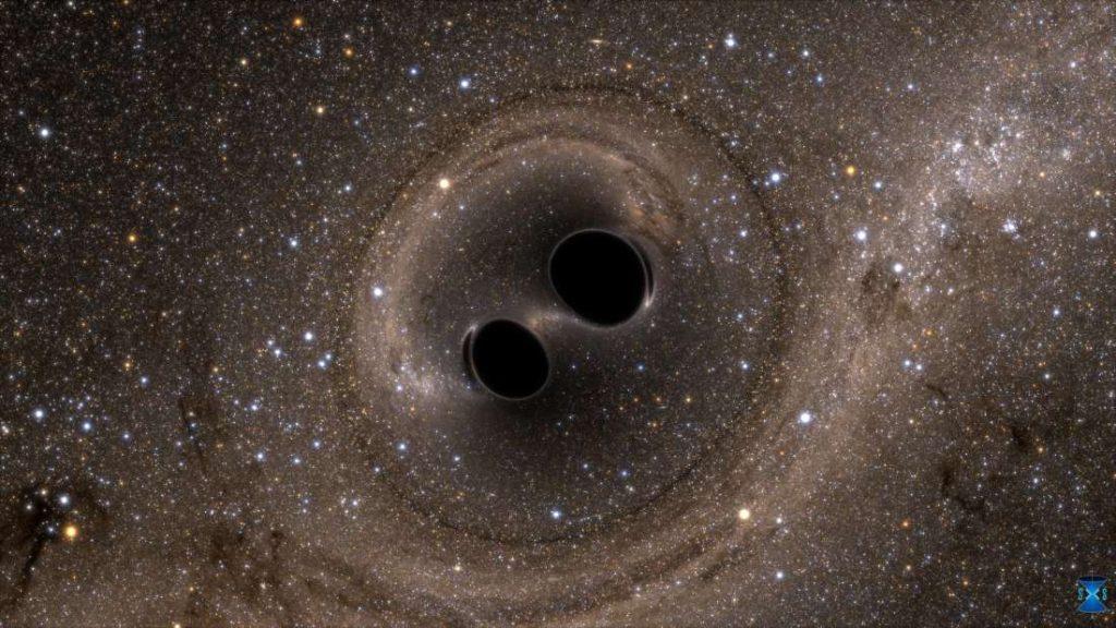 Representación artística de la fusión de dos agujeros negros