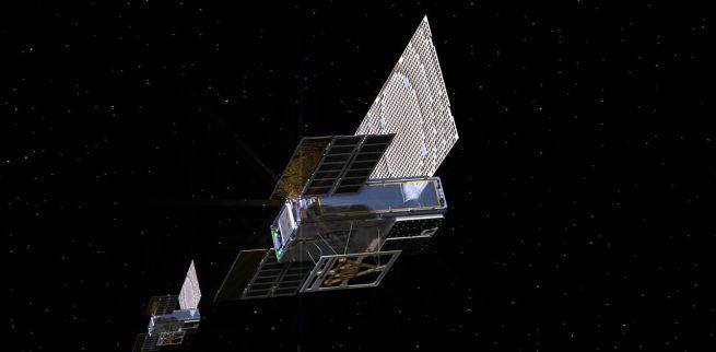 Representación de un artista de la nave espacial gemela Mars Cube One mientras vuelan por el espacio profundo