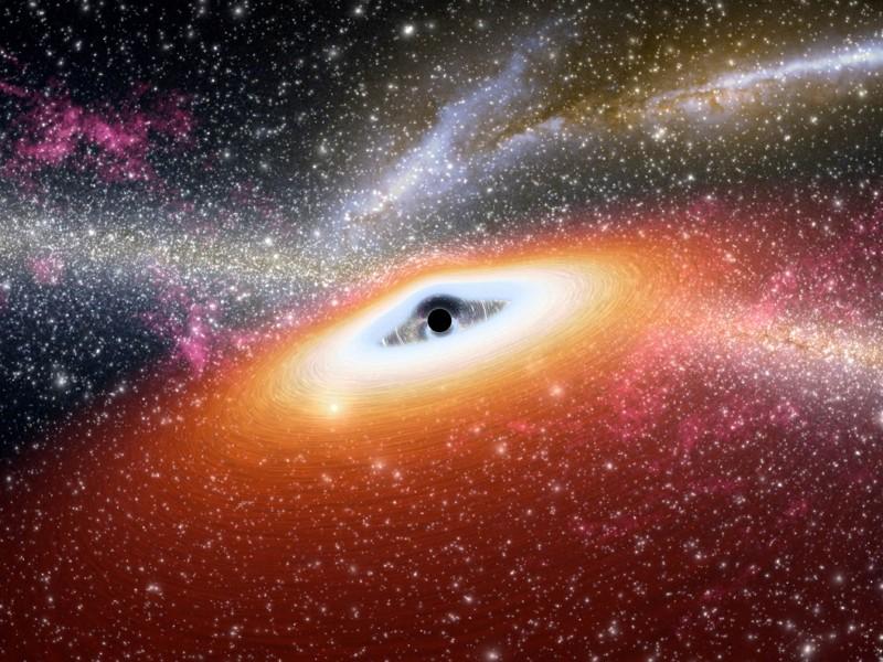 Representación artística que muestra uno de los agujeros negros supermasivos más primitivos que se conocen en el núcleo de una galaxia joven y rica en estrellas