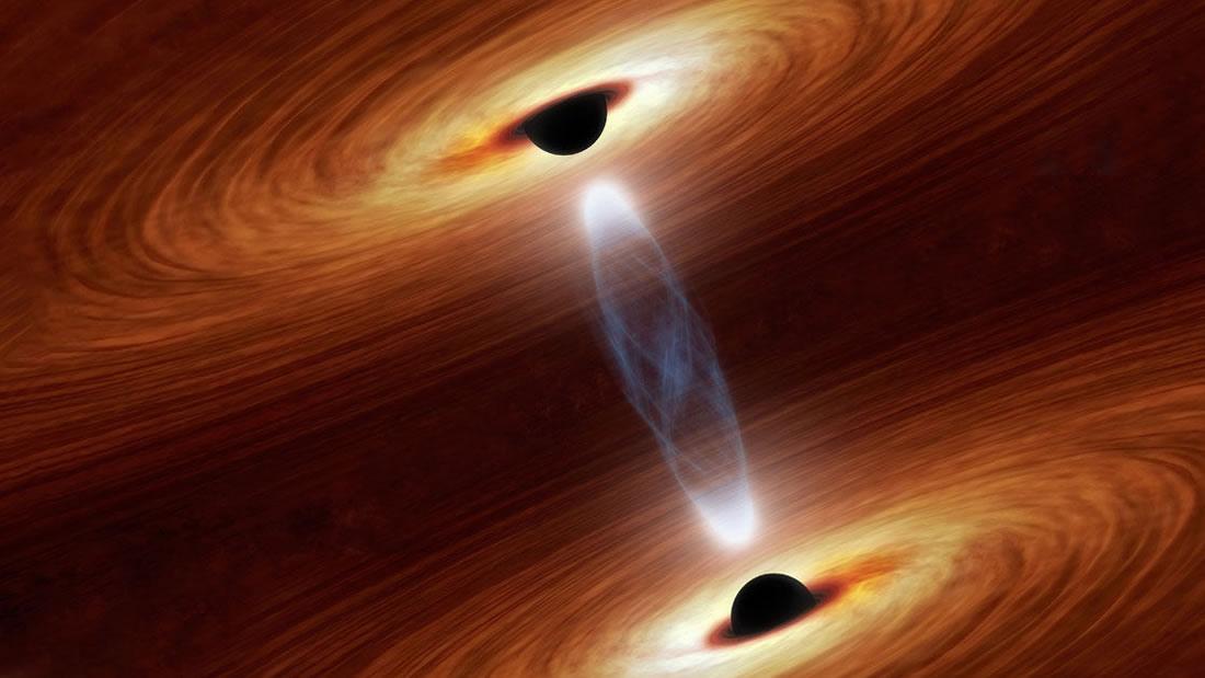 Dos agujeros negros supermasivos se dirigen en un curso devastador