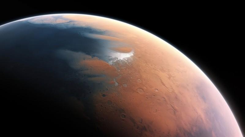 Representación artística muestra cómo pudo haberse visto Marte hace unos 4 mil millones de años cuando casi la mitad del hemisferio norte del planeta podría haber estado cubierto por un océano de hasta 1.6 kilómetros de profundidad en algunos lugares