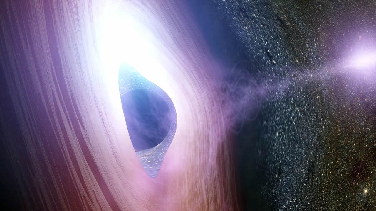 Según físicos: agujeros negros supermasivos pueden ser en realidad agujeros de gusano