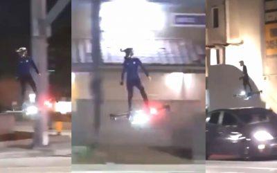 Hombre es visto volando por una ciudad montado en un artefacto similar a un drone