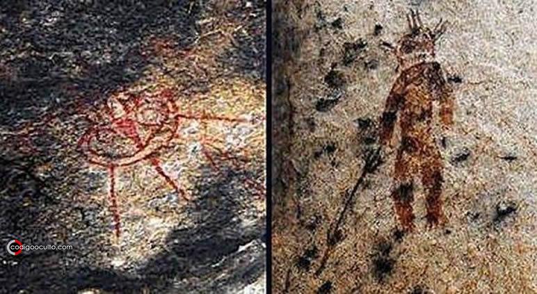 Una pintura rupestre mostrando un objeto circular, similar a una nave, y un extraño ser, que parece portar un traje de astronauta.